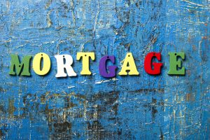 Mortgage word written of colorful wooden abc letter on abstract grounge background