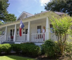 old-historical-home-in-southern-usa-front-porch-woman-texas-picture-id115904472