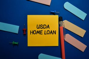 USDA Home Loan write on sticky note isolated on Office Desk.